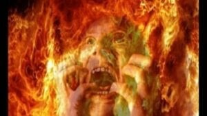 A person engulfed in fire screaming for mercy from suffering and pain in Hell.