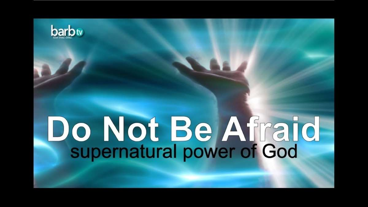 Hands raised praising God in return God's Supernatural Power coming down signified by white streaks penetrating person's fingertips.