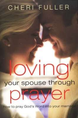 Happy wife and husband cuddling with smile on their faces with written statement, Loving Your Spouse Through Prayer.
