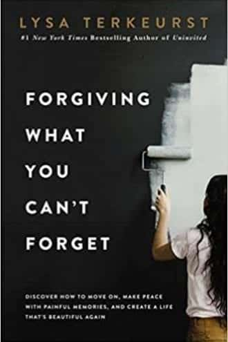 Black book cover with young girl painting black wall with white paint that signifies overcoming unforgiveness, Forgiving What You Can't Forget.